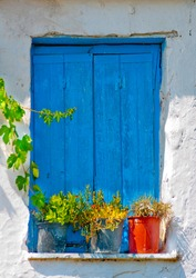 Blue colored window from  an old Greek house in Skiathos