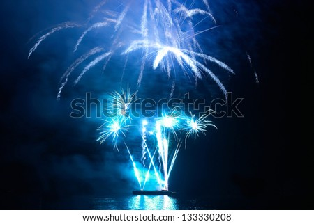 Blue colorful holiday fireworks on the black sky background.
