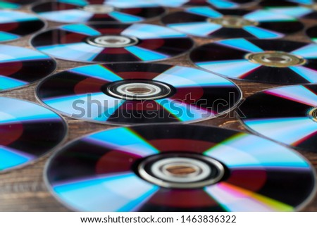 Blue compact discs wallpaper. Background of many colorful compact discs. Digital data storage technology concept.