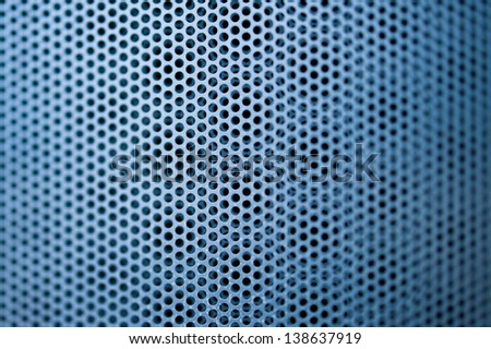 Blue construction metal grill seamless pattern with shallow depth of field. Tilt-shift lens used to accent the specific pattern and to emphasize the attention on it.