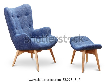 Blue, cornflower, dark blue color armchair and small chair for legs. Modern designer armchair on white background. Textile armchair and chair. Series of furniture.