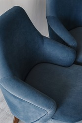 Blue, cornflower, dark blue color armchair. Modern designer armchair. Parts of the chair. Back, armrests and seat. Textile armchair. Series of furniture.