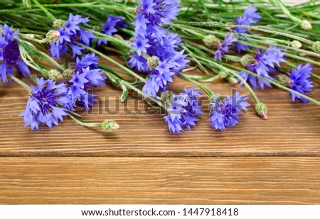 Blue cornflowers on a wooden background. Copy space. #1447918418