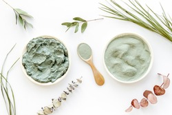 Blue cosmetic clay - face and body skin care - on white background top-down
