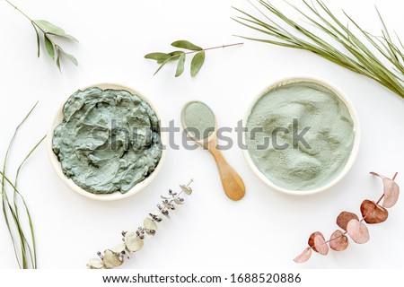 Blue cosmetic clay - face and body skin care - on white background top-down Сток-фото ©
