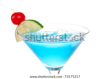 Blue Cosmopolitan cocktail with pina colada, blue curacao, white cranberry juice, lime, crushed ice and maraschino cherry in chilled martini glass isolated on a white background