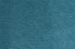 Blue crocodile leather skin background and texture