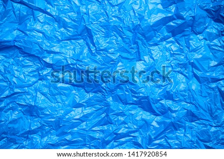 Blue crumpled plastic bag texture background. Waste recycle concept. Polyethylene clear garbage bags.  #1417920854