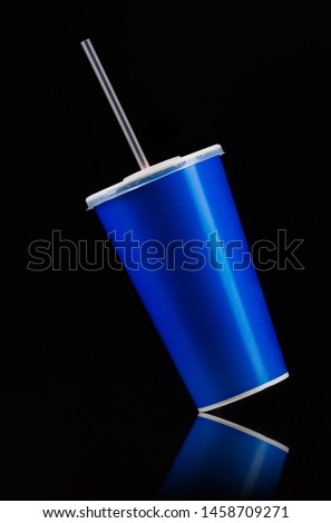 Blue cup with cap and tube isolated on black background. Concept of refreshments in cinema or watching movies #1458709271