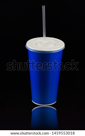 Blue cup with cap and tube isolated on black background. Concept of refreshments in cinema or watching movies #1459553018