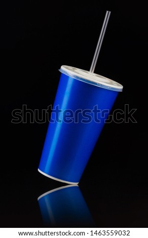 Blue cup with cap and tube isolated on black background. Concept of refreshments in cinema or watching movies #1463559032