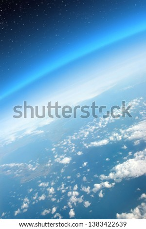 Blue curved stratosphere and troposphere. Planet earth segment with clouds, stars and continents seen from a very high plane perspective #1383422639