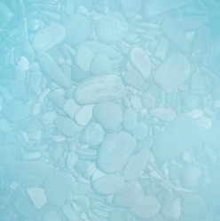 Blue cyan pebbles or smooth rocks or stones