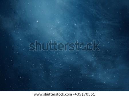 Blue dark night sky with many stars and moon