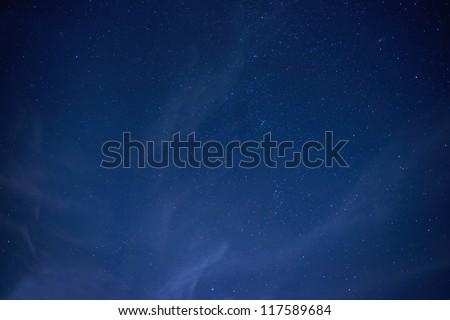 Blue dark night sky with many stars. Space background - stock photo