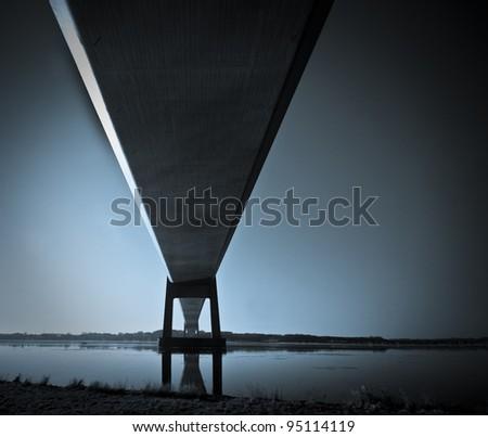 Blue dark suspension bridge - stock photo