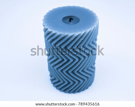 Blue decorated candle with zigzag pattern #789435616
