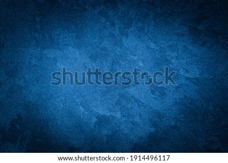 Blue decorative plaster texture with vignette. Abstract grunge background with copy space for design.