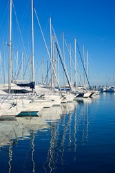 Blue Denia marina port in Alicante Spain with boats in a row