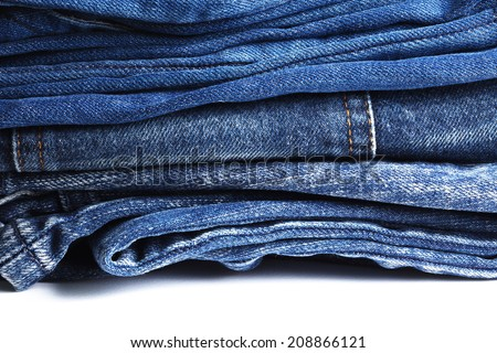 Blue denim jeans many pairs in dark color tone fold and stack up together.