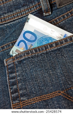 Blue denim jeans with a twenty euro note in the pocket