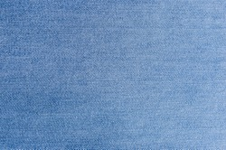 Blue denim textured background. Closeup texture and pattern of jeans fabric