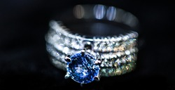 Blue diamond ring and bokeh
