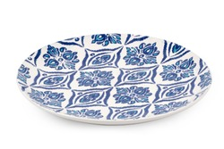 Blue dinner plate with oriental pattern isolated on white background.