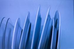 blue dish drainer con platos uno detras de otro, housework concept