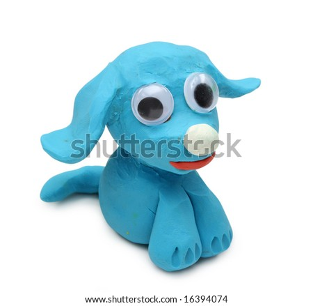 blue dog made from child's play clay isolated on white background