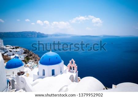 Blue dome church and the Sea in Oia, Santorini, Greece, Aegean Sea.