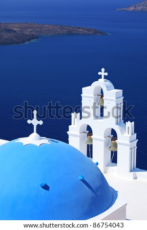 Blue dome Church St. Spirou in Firostefani on the island of Santorini Greece, overlooking the sea