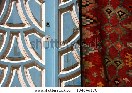 Blue door and carpet in Tunisia