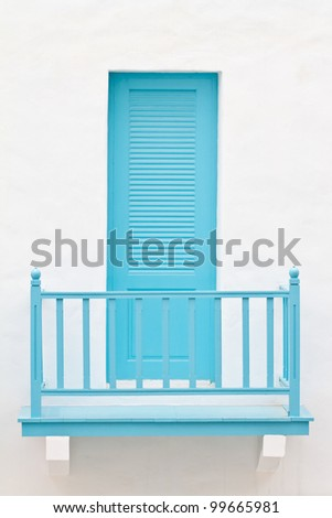 Blue door and terrace on white house