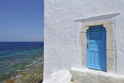 Blue Door by the sea Mykonos Greece