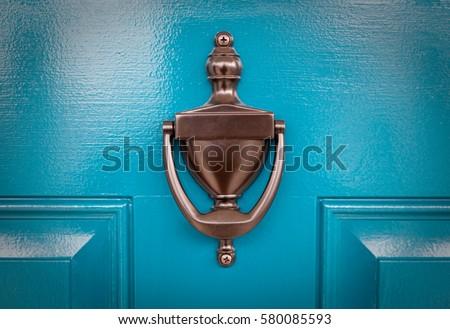 Blue Door  -  Freshly painted blue front door with bronze knocker - Shutterstock ID 580085593