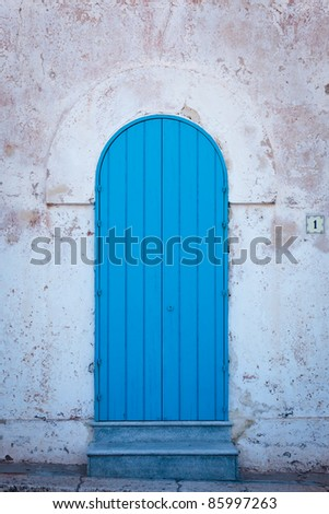 Blue door of a greek architecture style home in south of italy