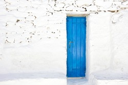 blue door of a traditional white house in mykonos island,Greece