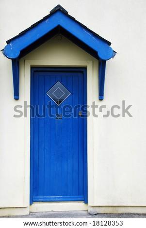 Blue door white plastered wall