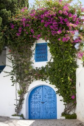 Blue doors, window and white wall of traditional building in Sidi Bou Said, Tunisia