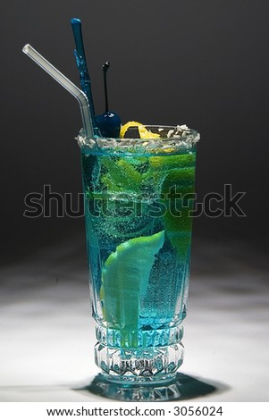 Blue drink with citron and ice. Studio shot.