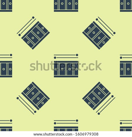 Blue Drum with drum sticks icon isolated seamless pattern on yellow background. Music sign. Musical instrument symbol.