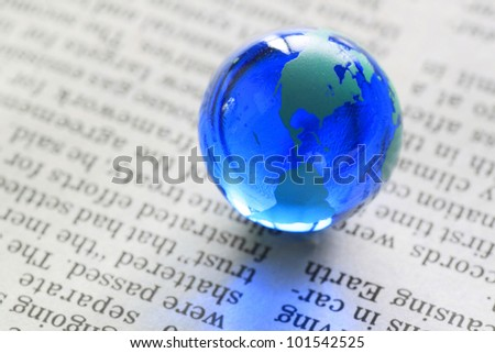 blue earth( Marble) on the  newspaper
