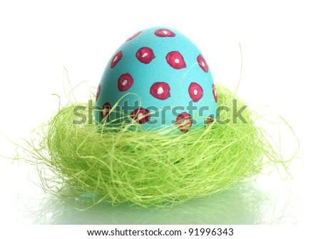 Blue Easter Egg in little bird nest isolated on white