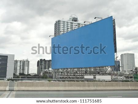 blue empty billboard on city.