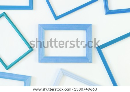 Blue empty frames laid out on a white background. Layout for the layout. Photo with space for text and images. #1380749663