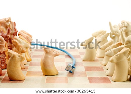 Blue ethernet cable running between an active game of chess, playing out on line games