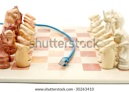 Blue ethernet cable running between chess set to depict on line gaming