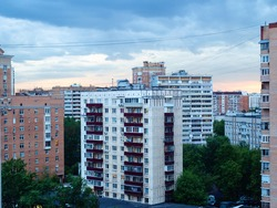 blue evening twilight over apartment houses in residential district in Moscow city in spring