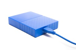 Blue external hard drive 2 terabytes with usb 3.0 port and micro-b wire for computer data storage backup isolated on white background.